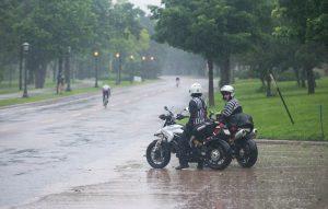 Moto refs take a break in the driving rain during the men's race. Photo: Casey B. Gibson | www.cbgphoto.com